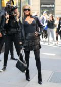 Paris Hilton pose for the camera as she arrives at AOL Build Series in New York City