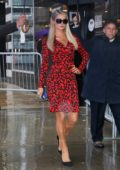 Paris Hilton wears a patterned red and black dress while visiting Good Morning America in New York City