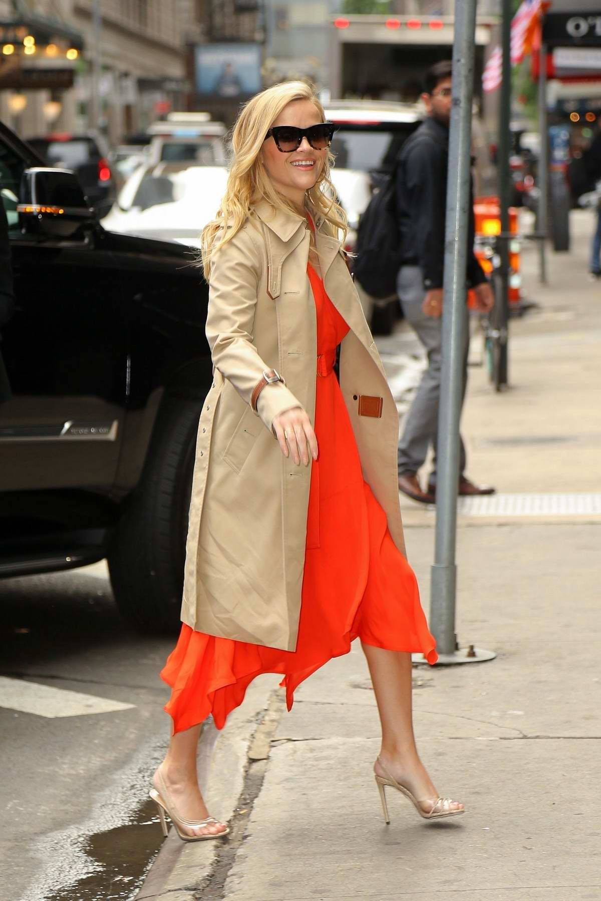 Reese Witherspoon looks striking in a bright red dress as she arrives at Good Morning America to promote 'Big Little Lies' in New York City