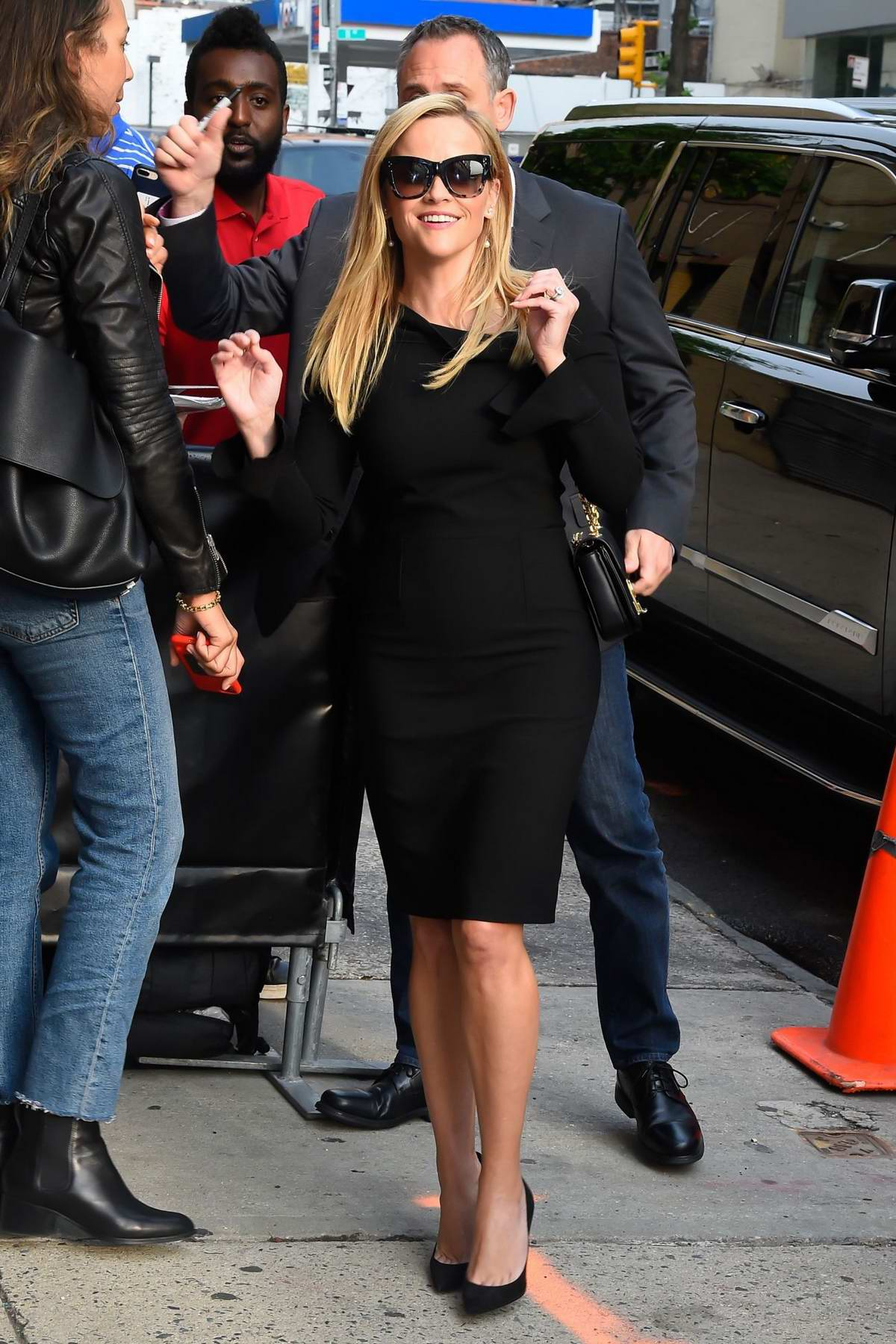 Reese Witherspoon smiles for camera as she arrives for her appearance on 'The Daily Show with Trevor Noah' in New York City