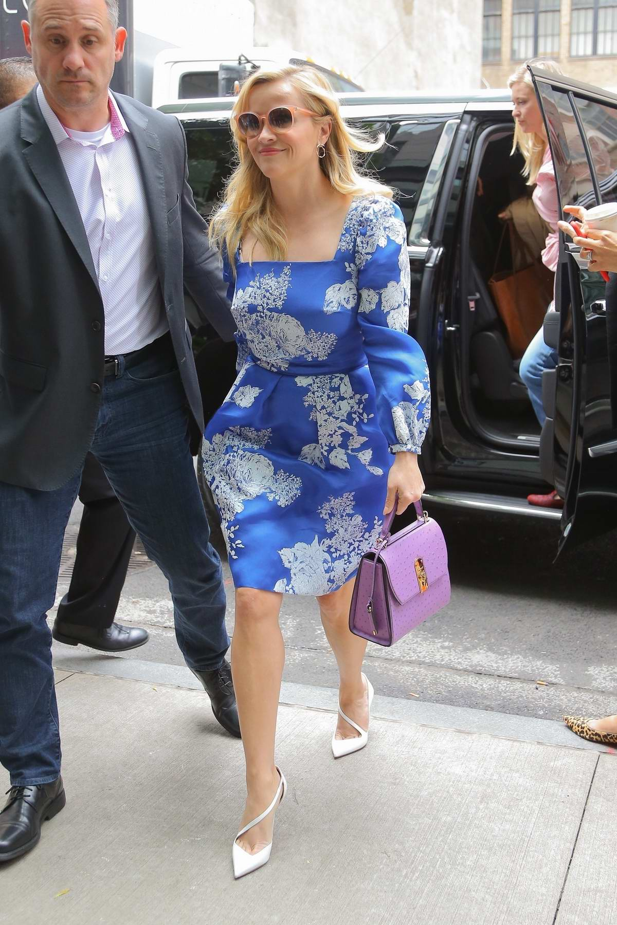 Reese Witherspoon steps out in a blue floral dress while promoting 'Big Little Lies' in New York City