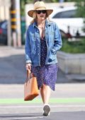 Reese Witherspoon wears a denim jacket, purple dress and sneakers while out shopping on Montana Ave in Brentwood, Los Angeles