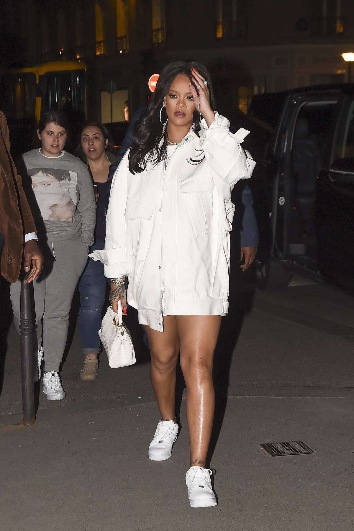 Rihanna rocks an all white ensemble as she heads to L'Avenue's after the Fenty Pop up Store event in Paris, France