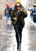 Rita Ora braves the rain in style while out in New York City