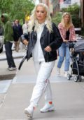 Rita Ora opts for a black leather jacket, white sweatsuit and Nike sneakers as she steps out of the Greenwich Hotel in New York City