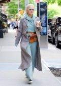 Rita Ora rocks a pair of cool shades as she steps out of her hotel in New York City