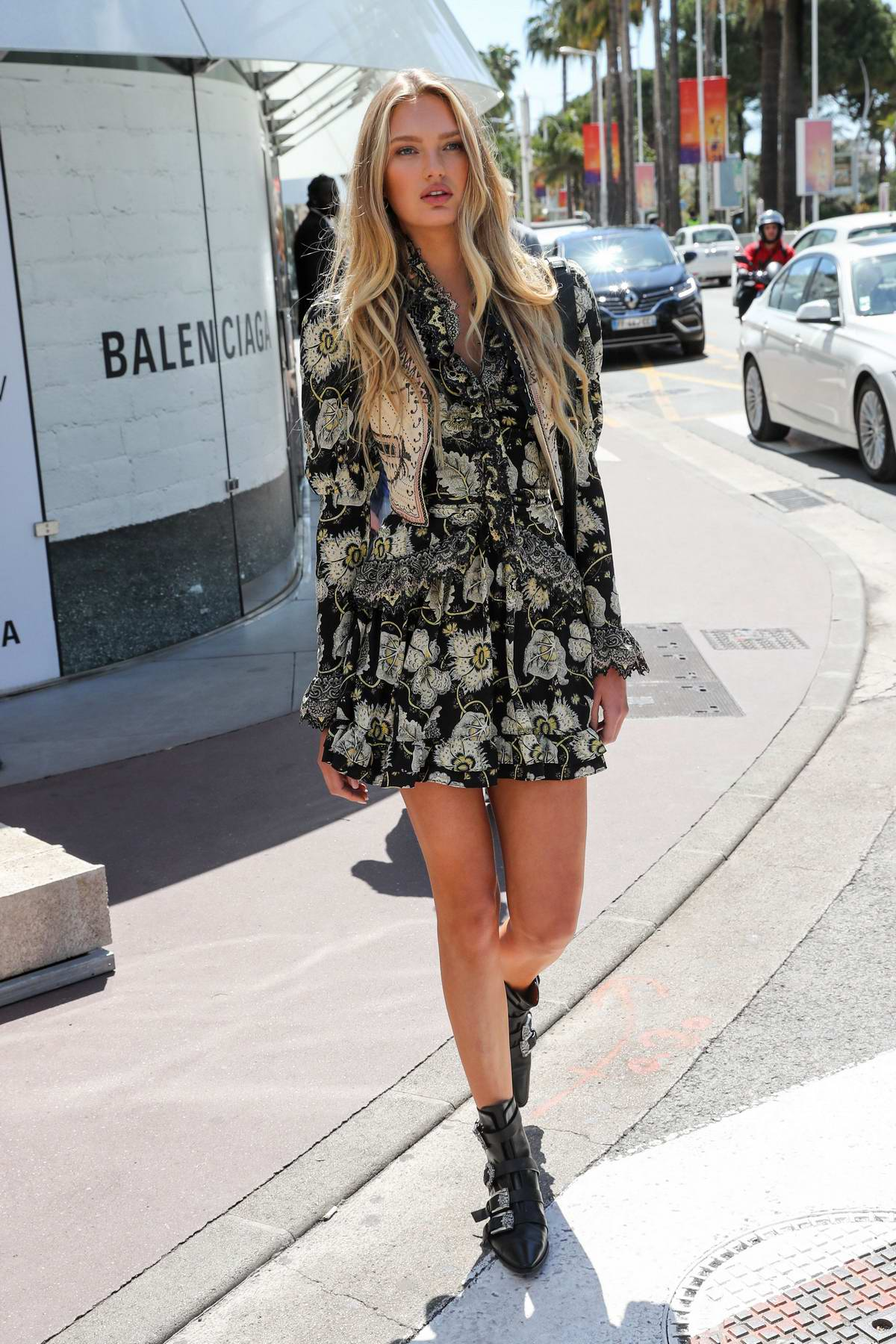 Romee Strijd steps out in a short floral print dress on the Croisette during the 72nd Cannes Film Festival in Cannes, France