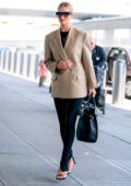 Rosie Huntington-Whiteley keeps it chic as she arrives for a flight out of JFK Airport in New York City