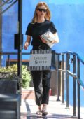 Rosie Huntington-Whiteley looks chic while out shopping at Couture Kids in West Hollywood, Los Angeles