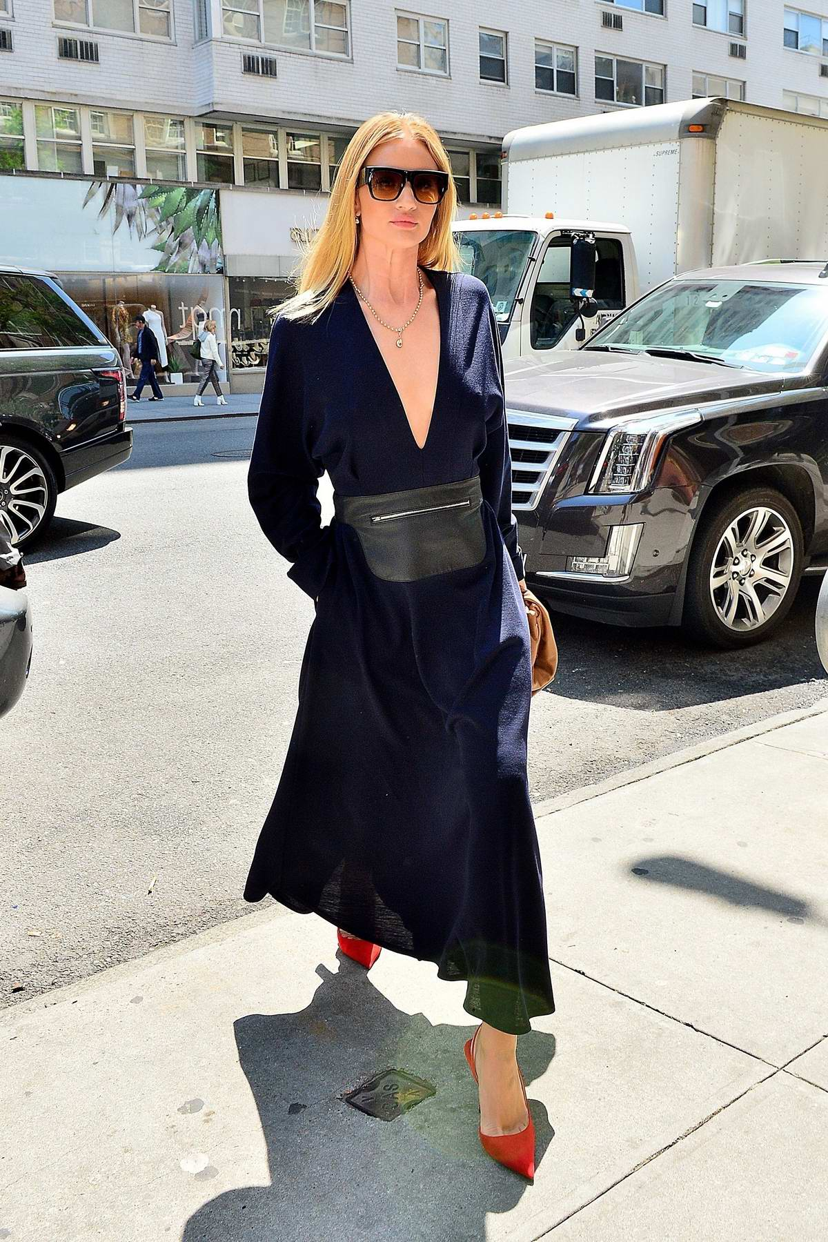 Rosie Huntington-Whiteley looks striking in a blue dress as she steps out in New York City