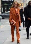 Rosie Huntington-Whiteley looks stunning in an orange ensemble while visiting AOL Build Series in New York City