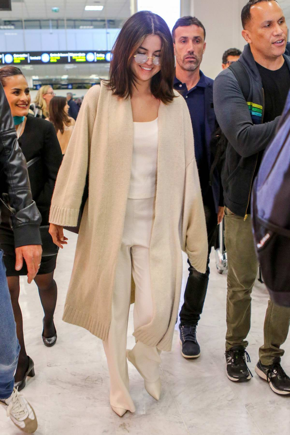 Selena Gomez is all smiles as she arrives at Nice airport ahead of the 72nd Cannes Film Festival , France
