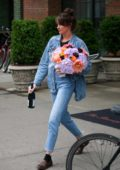Shailene Woodley steps out with a flower bouquet and a bottle of wine in Lower Manhattan, New York City