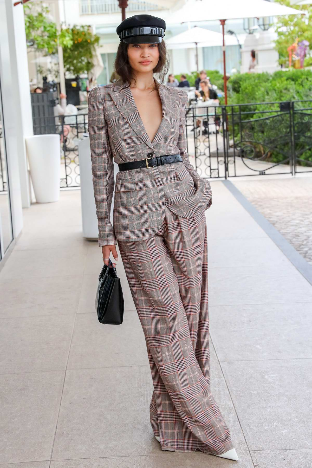Shanina Shaik looks stylish in a plaid suit while out during the 72nd annual Cannes Film Festival in Cannes, France