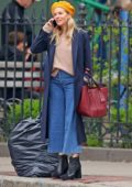 Sienna Miller spotted in a mustard colored beret with navy blue long coat while out in New York City