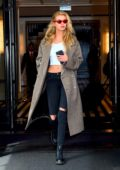 Stella Maxwell looks striking in a plaid coat as she leaves The Mark in New York City