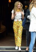 Suki Waterhouse wears bright yellow floral pants with a white top as she leaves The Bowery Hotel in New York City