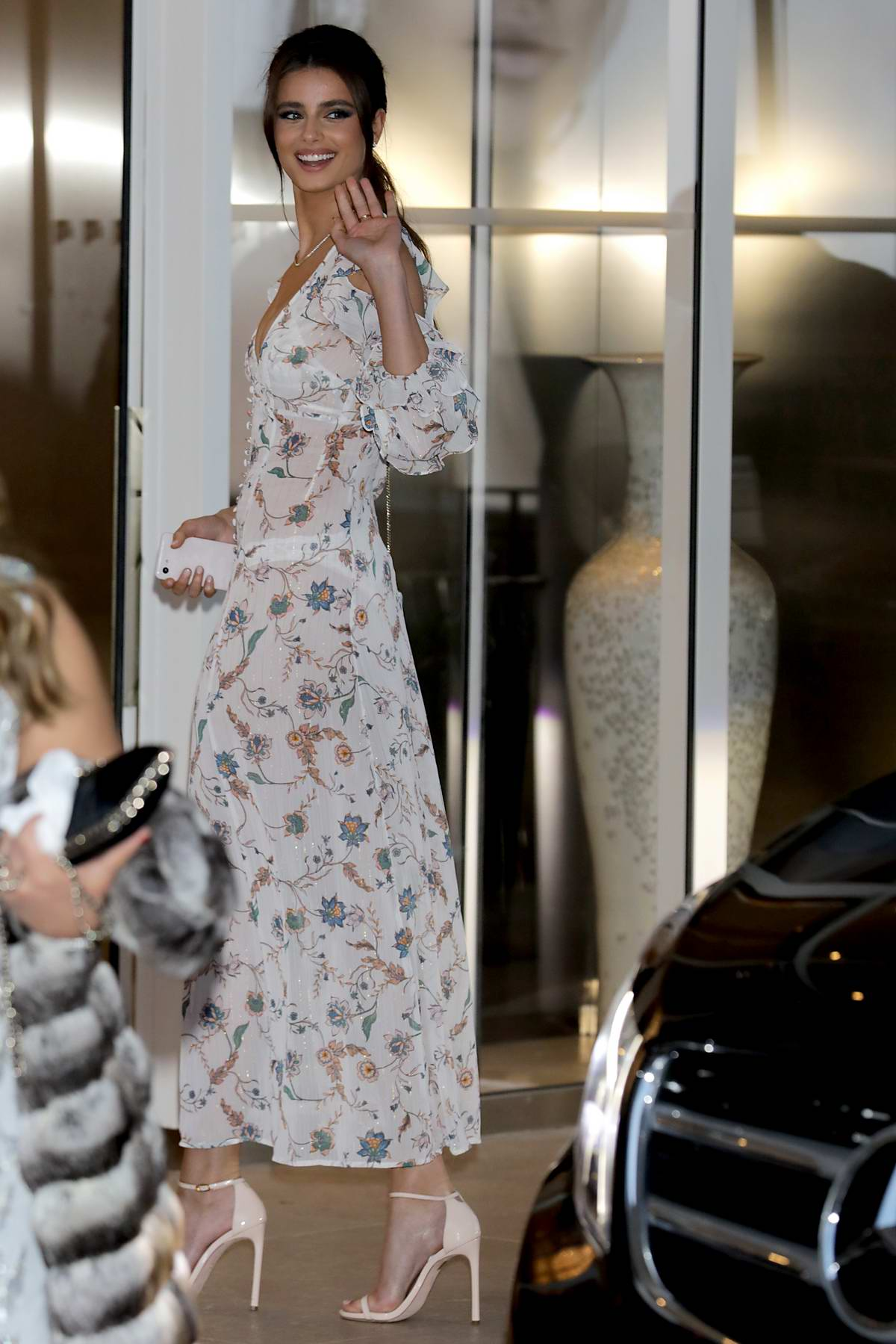 Taylor Hill looks stunning in a sheer floral dress as she leaves hotel Martinez during 72nd Cannes Film Festival in Cannes, France