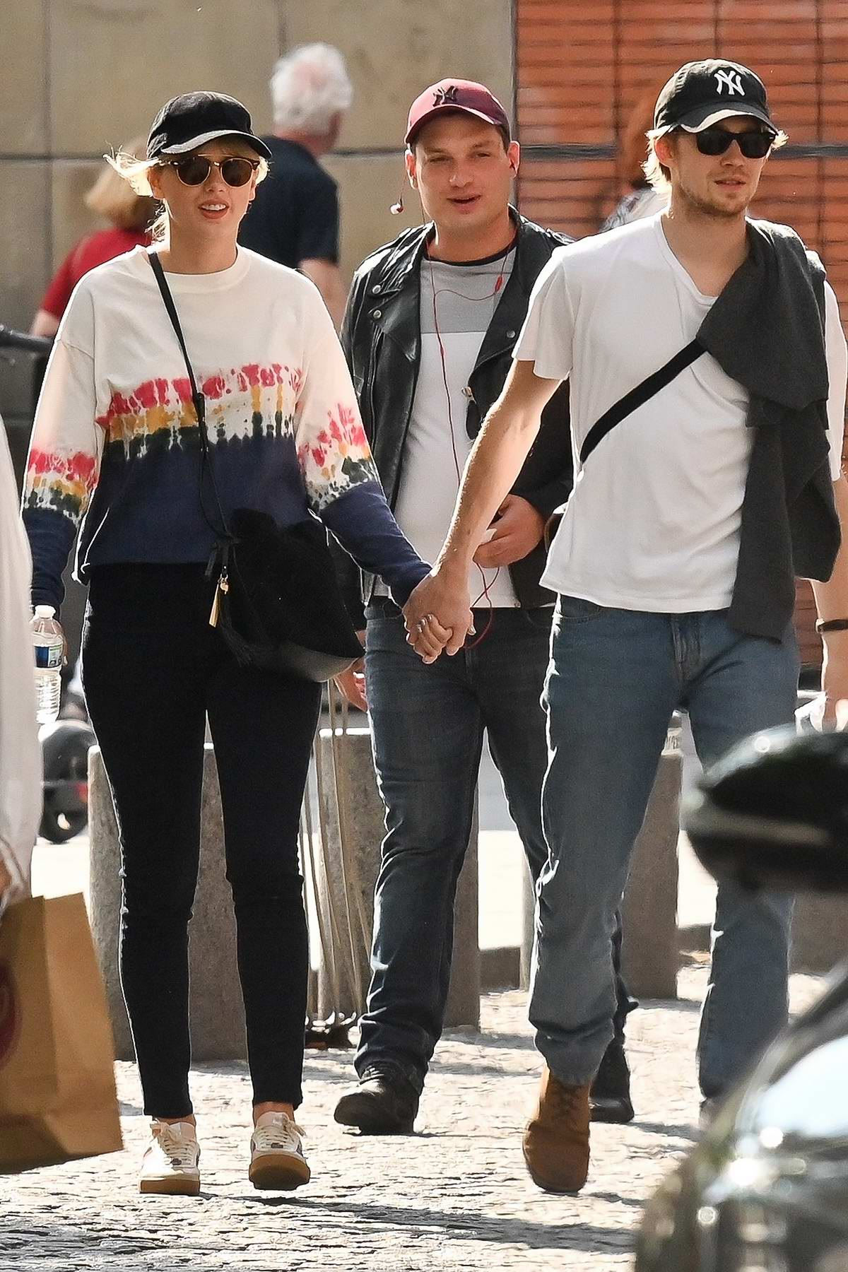 Taylor Swift and Joe Alwyn hold hands while out for a stroll in Paris, France