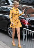 Taylor Swift wears a cute yellow dress as she greets her fans while visiting NRJ Radio Station in Paris, France