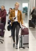 Toni Garrn spotted in a brown suede jacket, white tee and leggings as she arrives to catch a flight out of Montreal, Canada