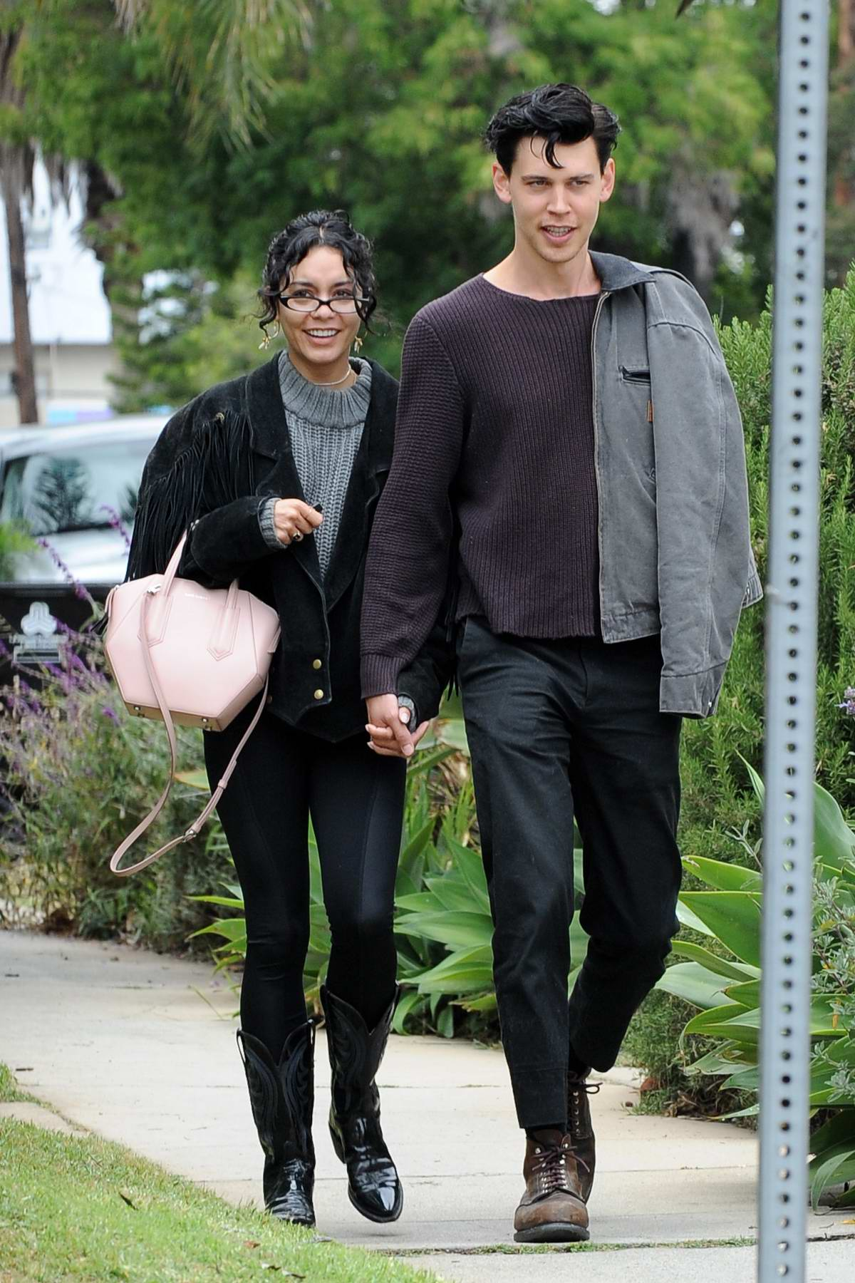 Vanessa Hudgens and Austin Butler hold hands on a stroll in Los Angeles