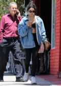 Vanessa Hudgens grabs an iced coffee after wrapping up a workout session in Los Angeles