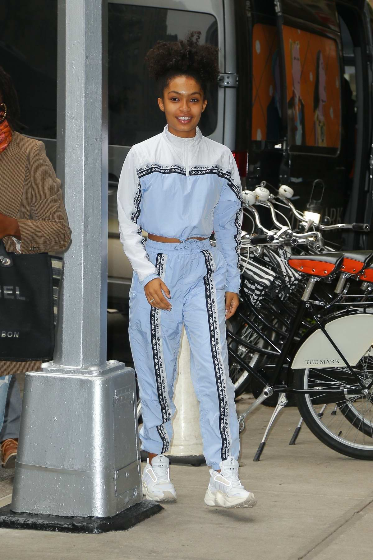 Yara Shahidi heads out of her hotel in an Adidas tracksuit in New York City