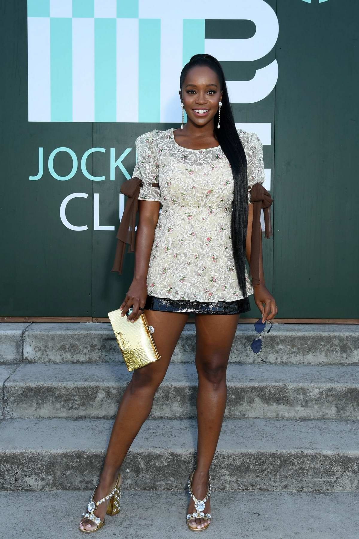 Aja Naomi King attends Miu Miu Club event at Hippodrome d'Auteuil in Paris, France