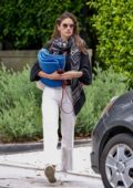 Alessandra Ambrosio keeps it casual chic in black shirt and white jeans as she leaves her home on a moving day in Brentwood, Los Angeles