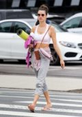 Alessandra Ambrosio strolls back to her car after a yoga class in Santa Monica, California