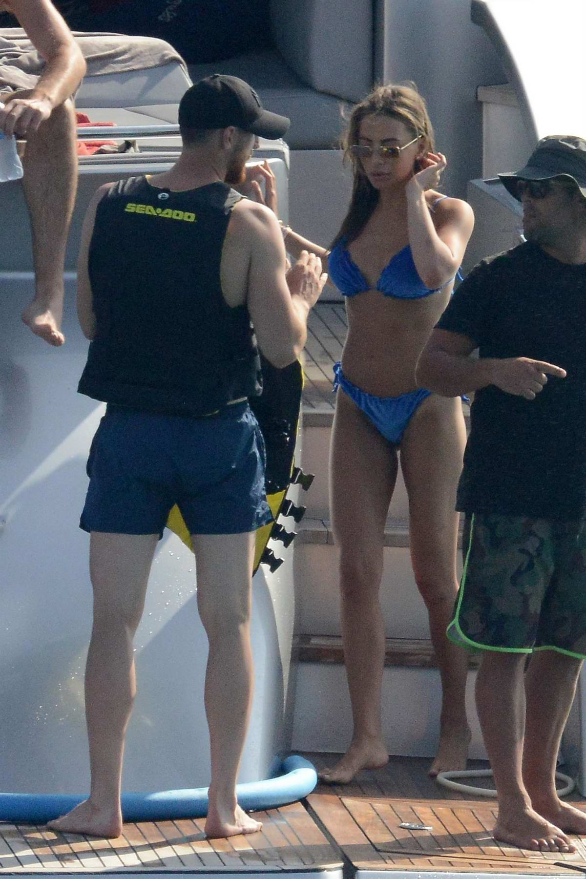 Alessia Tedeschi gets in a blue bikini and lounges on a yacht with Jan Obla in Formentera, Spain
