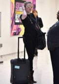 Amber Heard looks great in all-black outfit and leopard print boots as she arrives at LAX Airport in Los Angeles