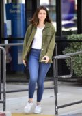 Ana de Armas wears a green denim jacket, white tee and skintight jeans while out running errands in Los Angeles