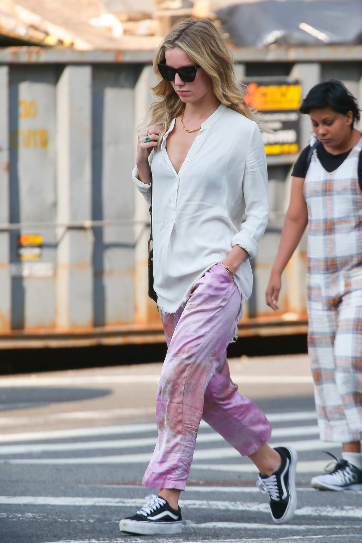 Annabelle Wallis looks stylish in an off-white shirt and pink satin pants while out in New York City