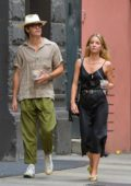 Annabelle Wallis wears a black satin dress while out with Chris Pine in downtown Manhattan, New York City