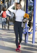 AnnaLynne McCord dons a white turtleneck and grey leggings while out in Los Angeles