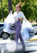 Ariel Winter wears an off-white crop top and purple plaid pants while shopping at Bed Bath & Beyond in Studio City, California