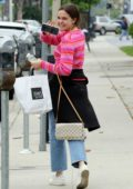 Bailee Madison smiles for the camera while she picked up lunch to go at Joan's On Third in Studio City, Los Angeles