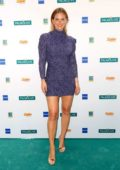 Bar Refaeli shows off her baby bump in a purple mini dress while attending the Palmolive Model Night in Hamburg, Germany