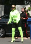 Bebe Rexa glows in neon green while out in Los Angeles