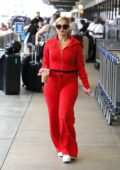 Bebe Rexha dazzles in red as she arrives at LAX airport in Los Angeles