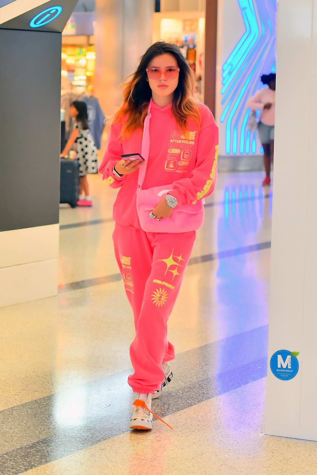 Bella Thorne sports all-pink sweatsuit as she jets out of LAX airport in Los Angeles