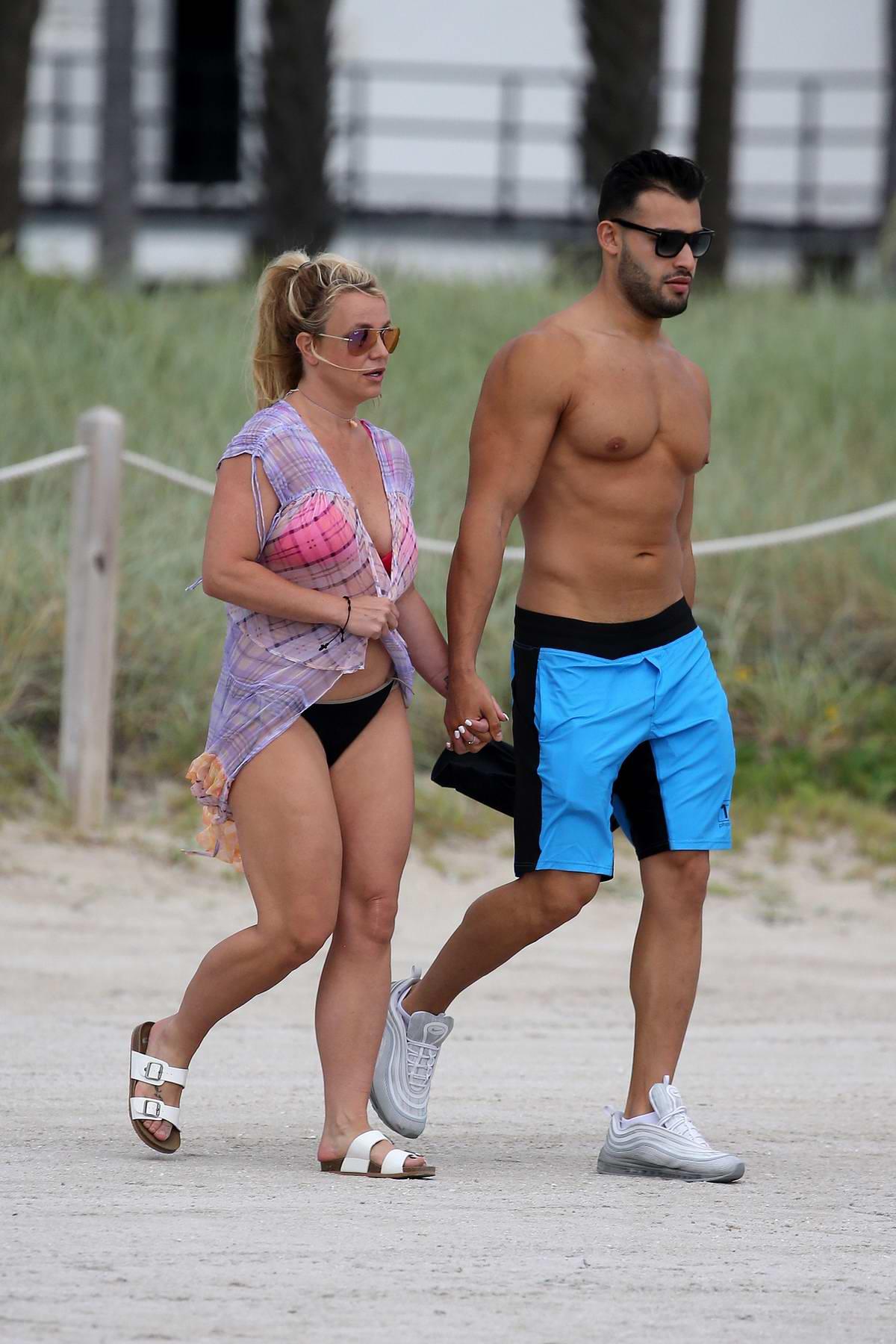 Britney Spears takes a jet ski ride while enjoying a beach day with boyfriend Sam Asghari in Miami, Florida