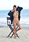 Brooke Burke shows off her beach body in a colorful bikini while filming for her app 'BrookeBurkeBody' in Malibu, California