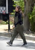 Camila Cabello steps out in olive green overalls, black top and Adidas trainers in Los Angeles