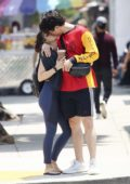 Camila Mendes And Charles Melton share a kiss as they leave the gym in Los Angeles