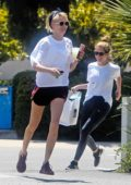 Cara Delevingne and Ashley Benson fool around playing tag with each other on an afternoon hike with their dogs in Los Angeles