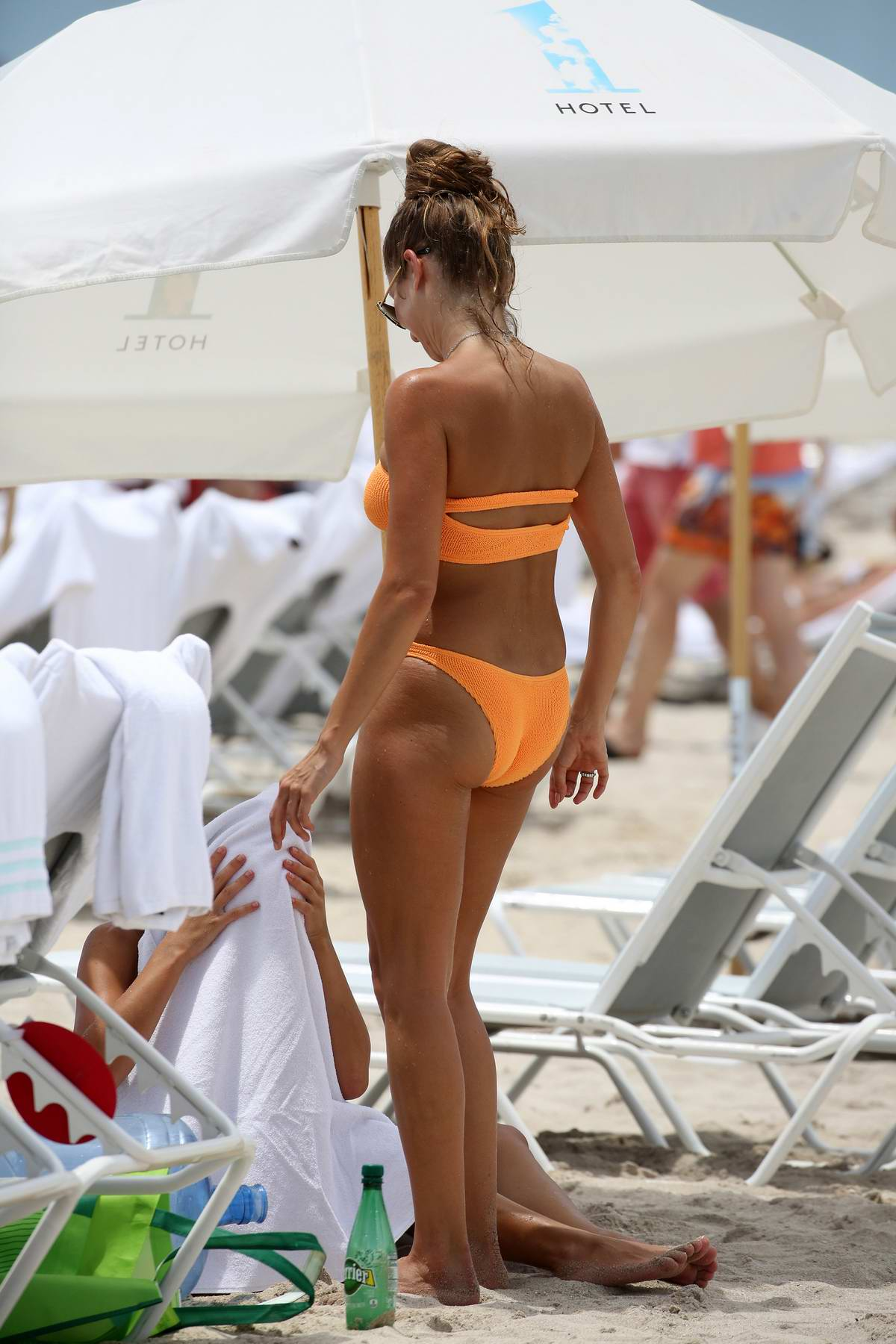 Angelica Celaya En Bikini cathy hummels wears an orange bandeau bikini as she hits the