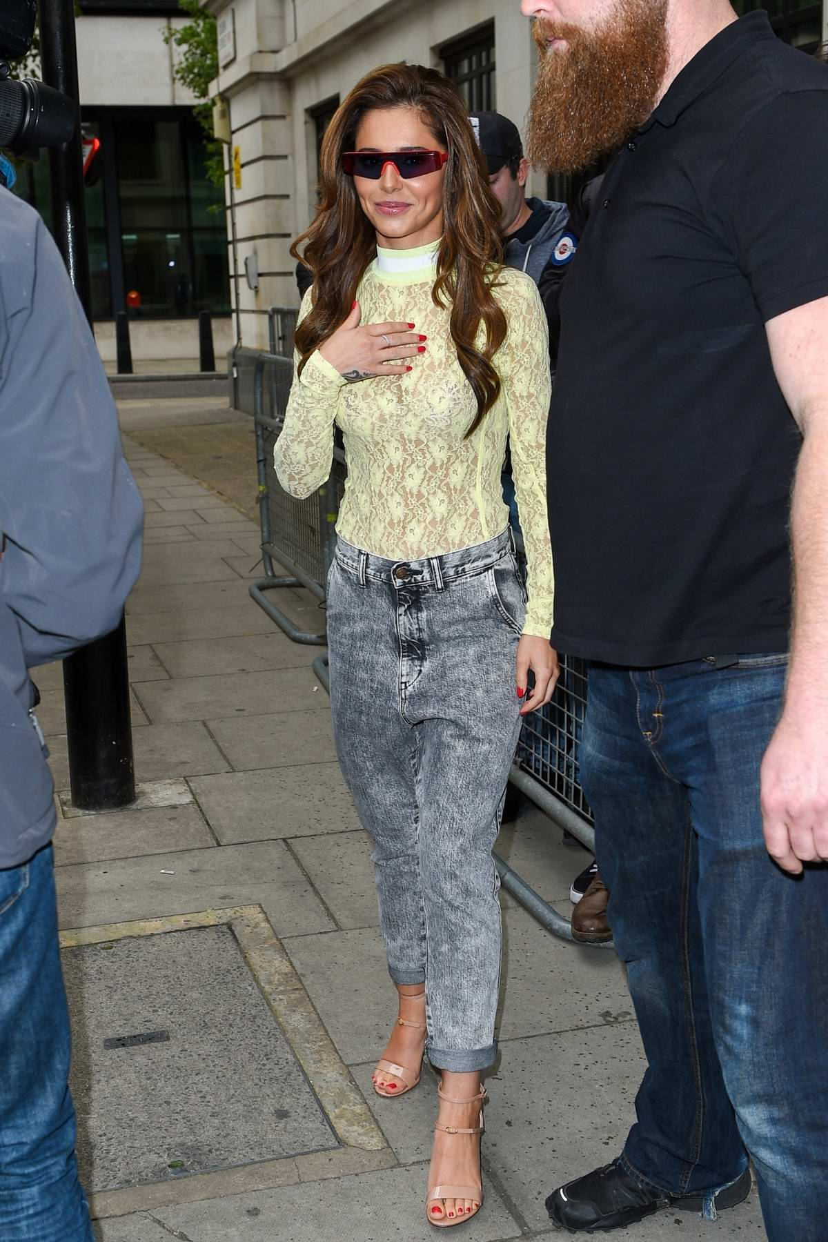 Cheryl Tweedy greets fans as she leaves BBC Radio 2 studios in London, UK